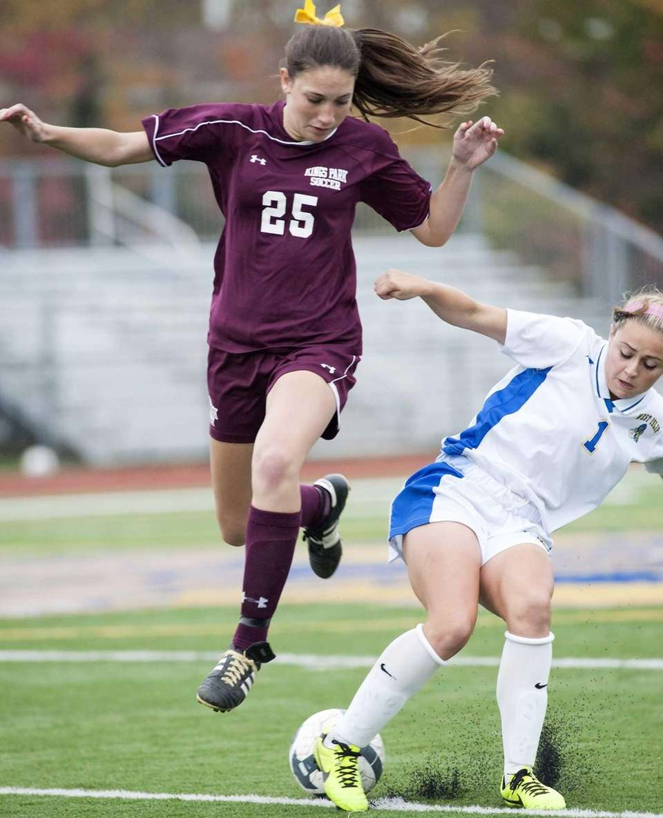 West Islip's Kylie Walsh, right, breaks up a