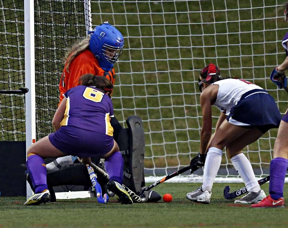 Miller Place's goalie Carly Olsen kicks away a