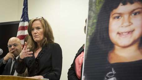 Nassau County District Attorney Kathleen Rice with victims