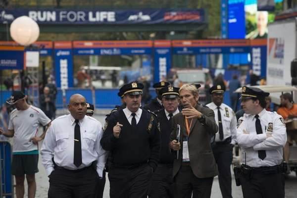 High ranking members of the NYPD walk along