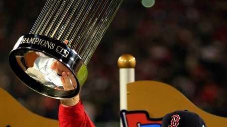 Boston Red Sox manager John Farrell holds up