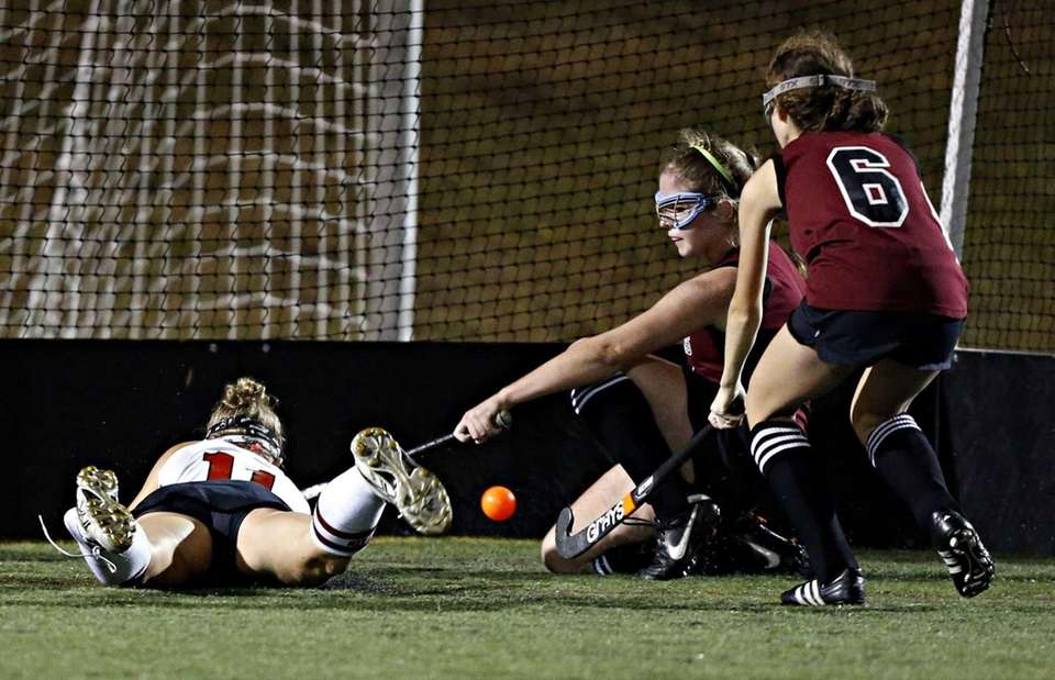 A diving Kasey Gilbride punches the ball into
