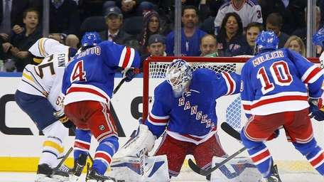 Henrik Lundqvist of the Rangers makes a second-period
