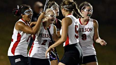 Pierson teammates celebrate the first goal of the