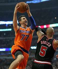 Andrea Bargnani drives against the Chicago Bulls' Carlos