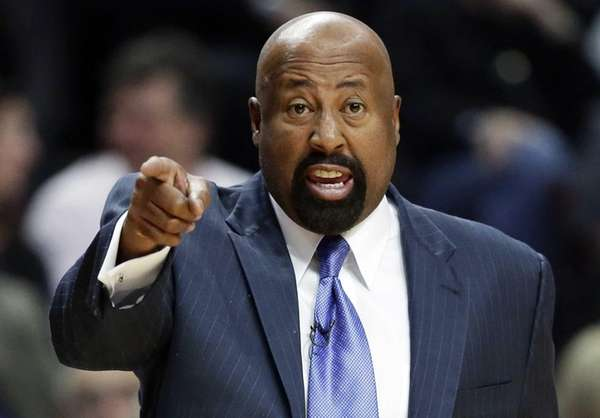 Mike Woodson points as he talks to his