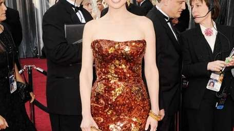 Ellie Kemper arrives at the 84th Academy Awards