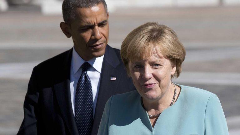 President Barack Obama walks with Germany's Chancellor Angela