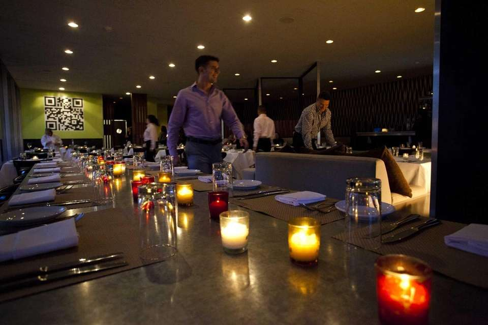 A candlelit table at The Riverhead Project in
