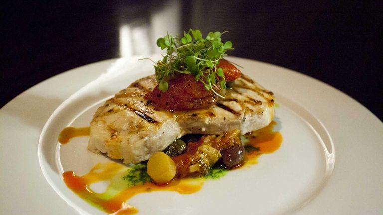 The grilled center-cut swordfish, with roasted tomato, kalamata