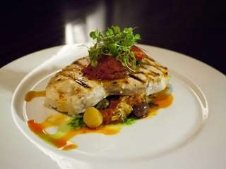 The grilled center-cut swordfish, with roasted tomato, kalamata