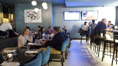 Diners in the rear dining room at Revel