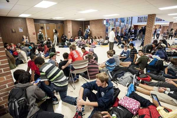 Students sits in the front hallway at Southampton