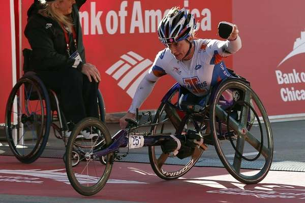 Tatyana McFadden, of Champaign, Ill., crosses the finish