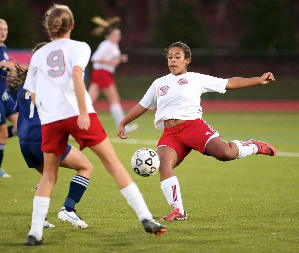 Southold's Isabella Simon clears the ball in the