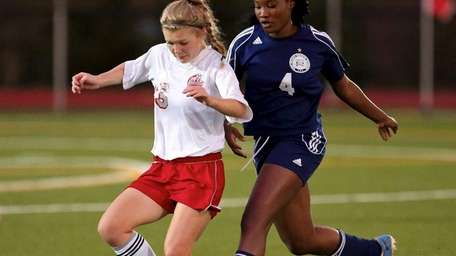 Southold's Justina Babcock moves the ball through midfield