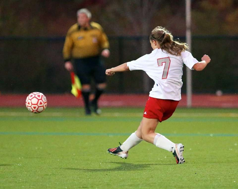 Southold's Rosemary Volinski puts the shot on goal