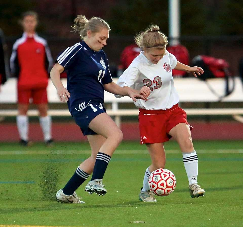 Southold's Justina Babcock battles with Stony Brook's Sydney