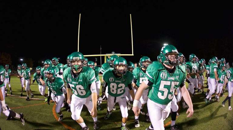 The Farmingdale Dalers charge onto the field prior