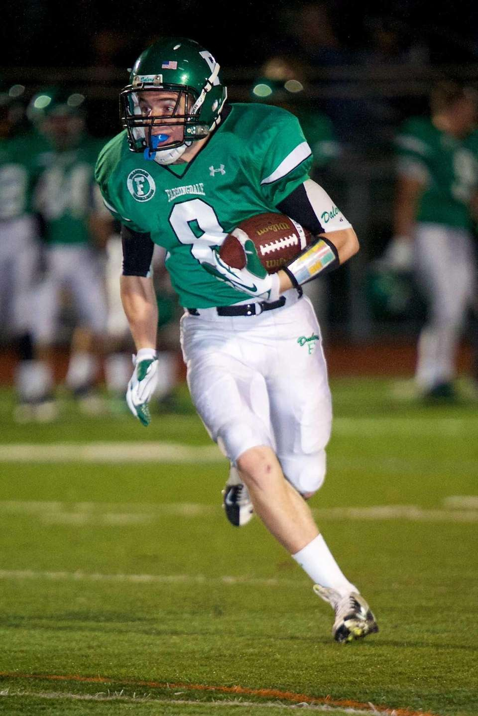 Farmingdale receiver Tom Kennedy sprints toward the endzone