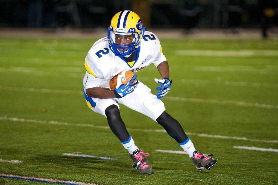 East Meadow running back Damian Sanders looks to