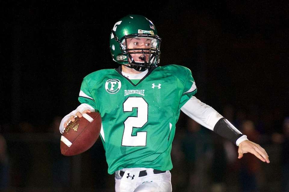 Farmingdale quarterback Vinny Quinn looks for an open