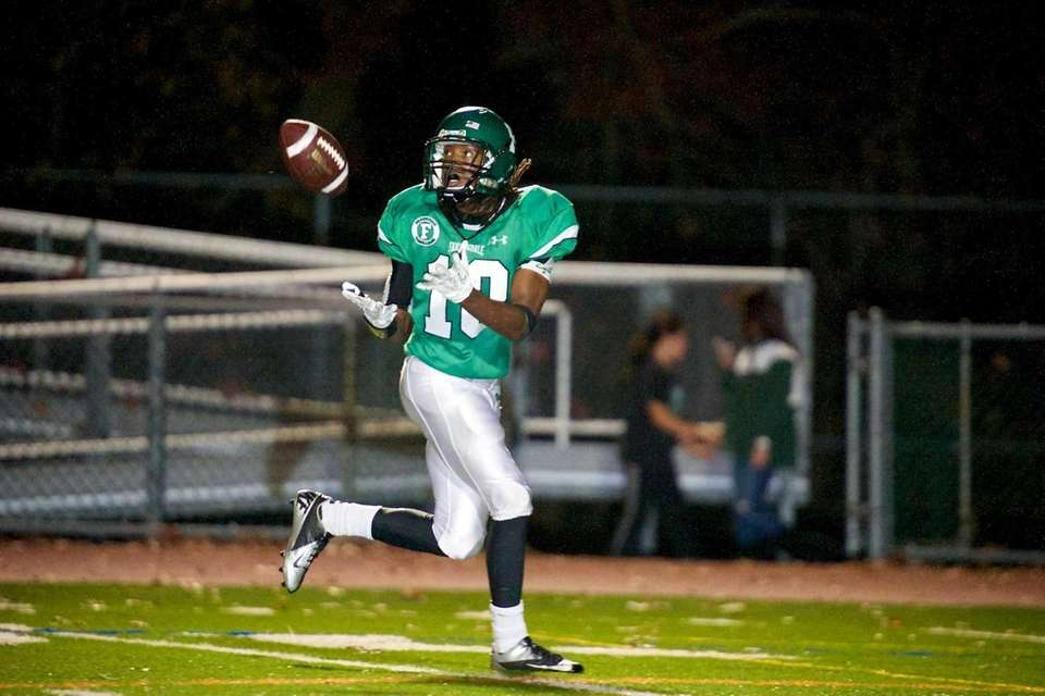 Farmingdale running back Curtis Jenkins brings in a