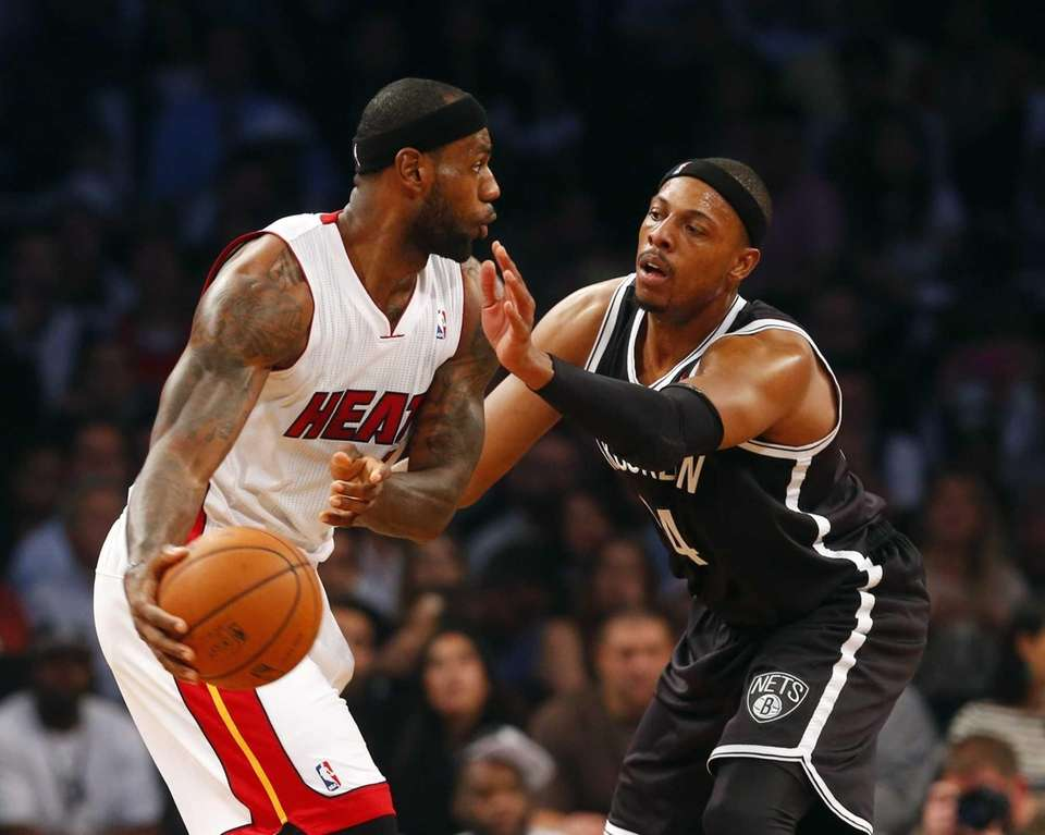 Paul Pierce of the Nets defends against LeBron