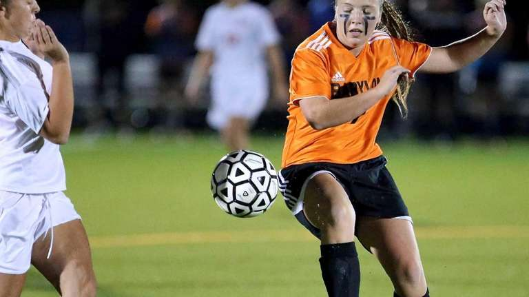 Babylon's Hallie Merz clears the ball out of