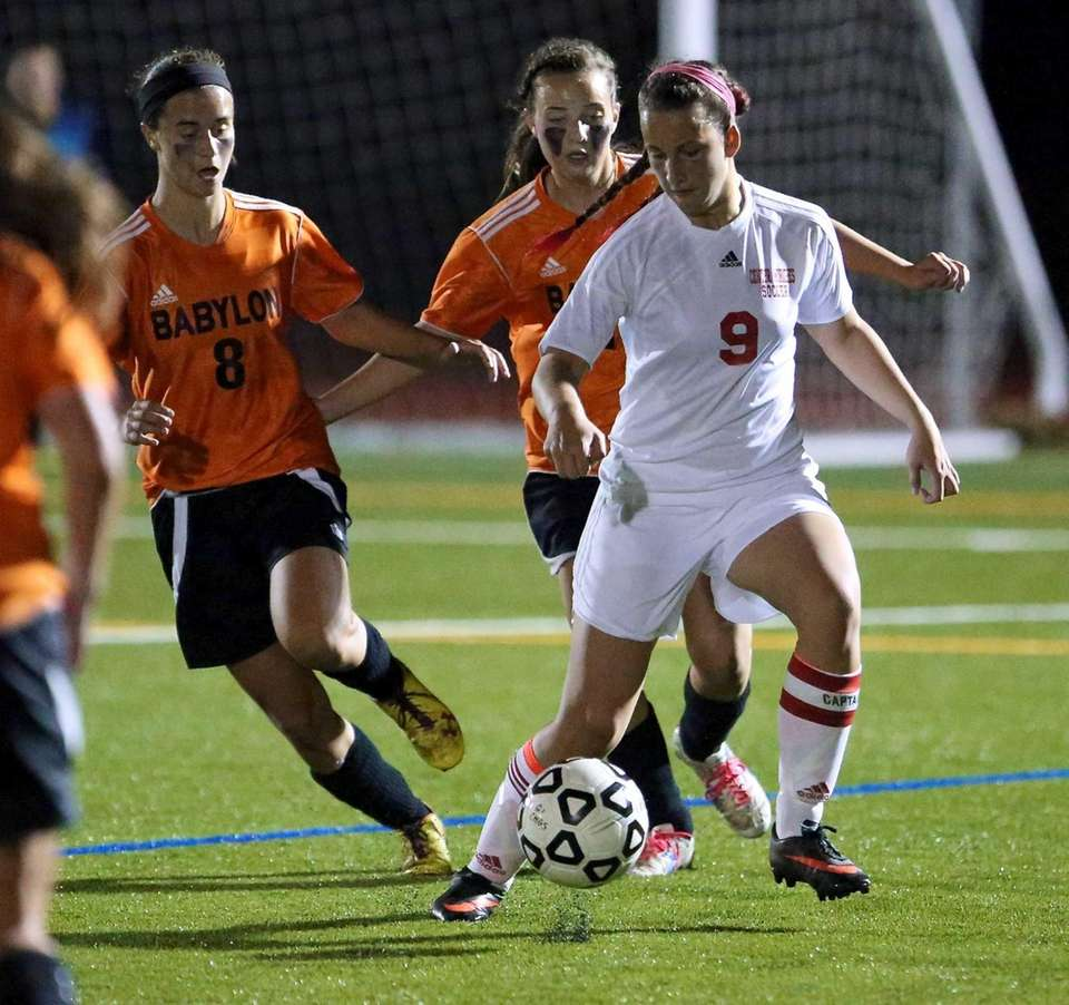 Center Moriches' Pam Schenck looks for room as