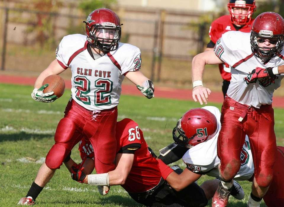 Glen Cove running back Billy Neice gains yardage