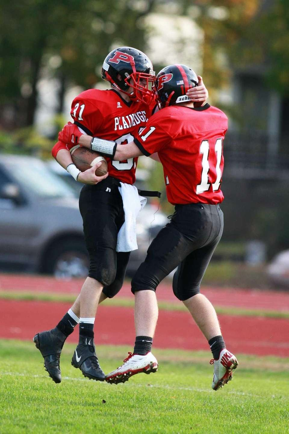 Plainedge wide receiver John Gullo, left, celebrates in