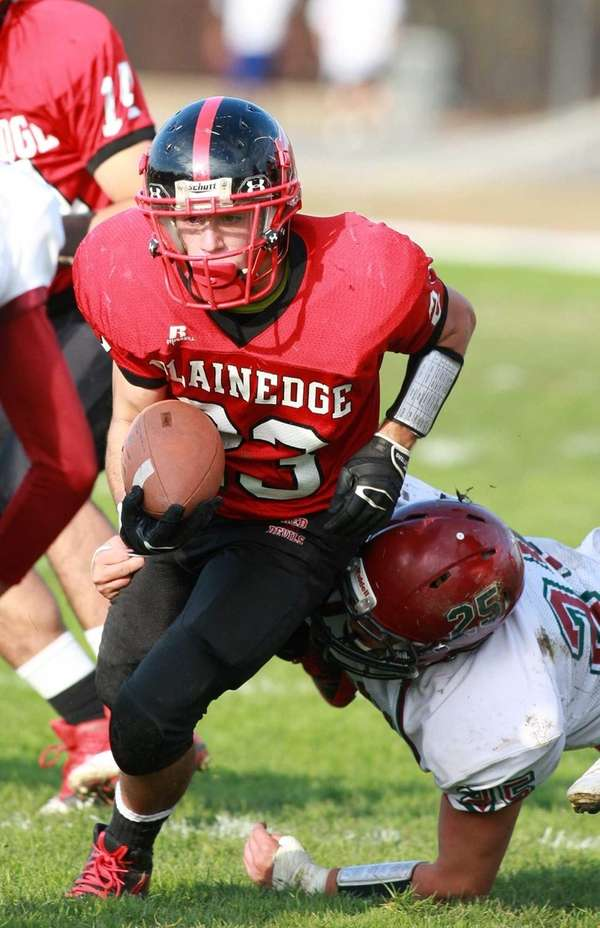 Plainedge running back Gianfranco Soriente gains yardage against