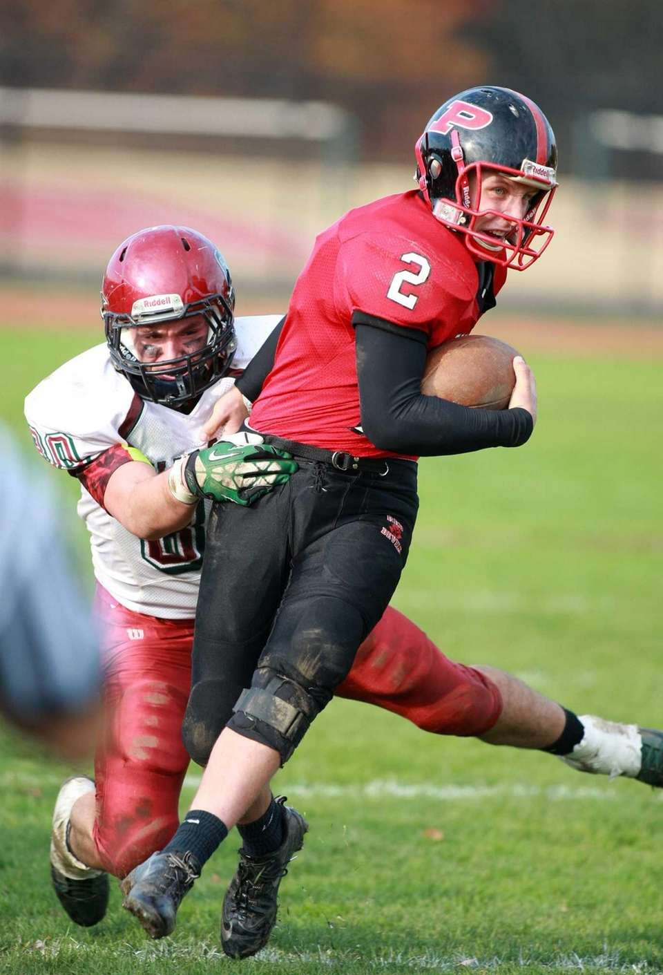 Plainedge quarterback Nick Frenger tries to break free