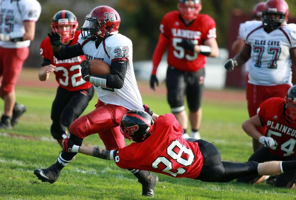 Glen Cove running back Ryan Perkins gains yardage