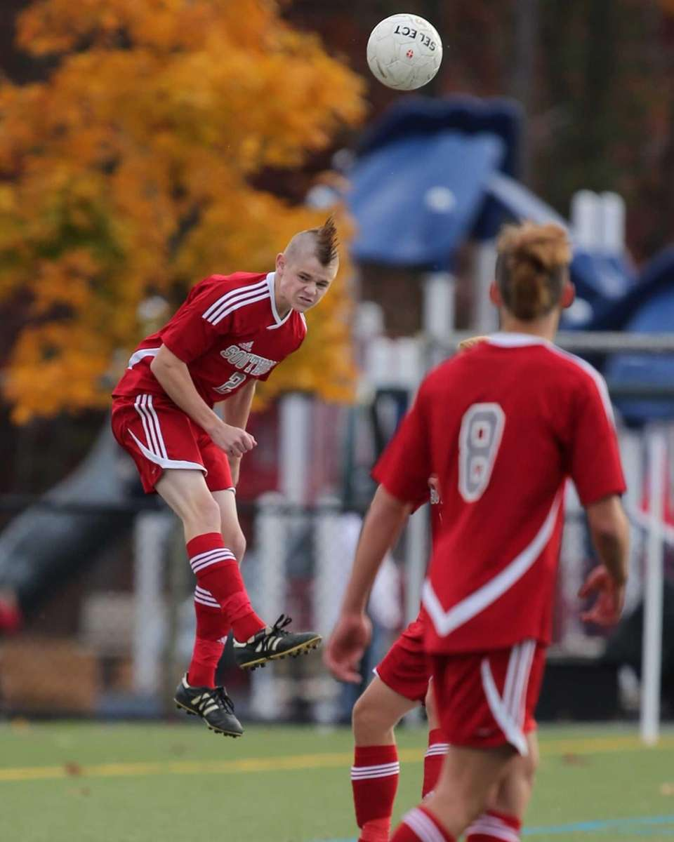 Southold's Peter Fouchet (no. 2) heads the ball