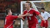 Southold's Drew Sacher (no. 8) celebrates his goal