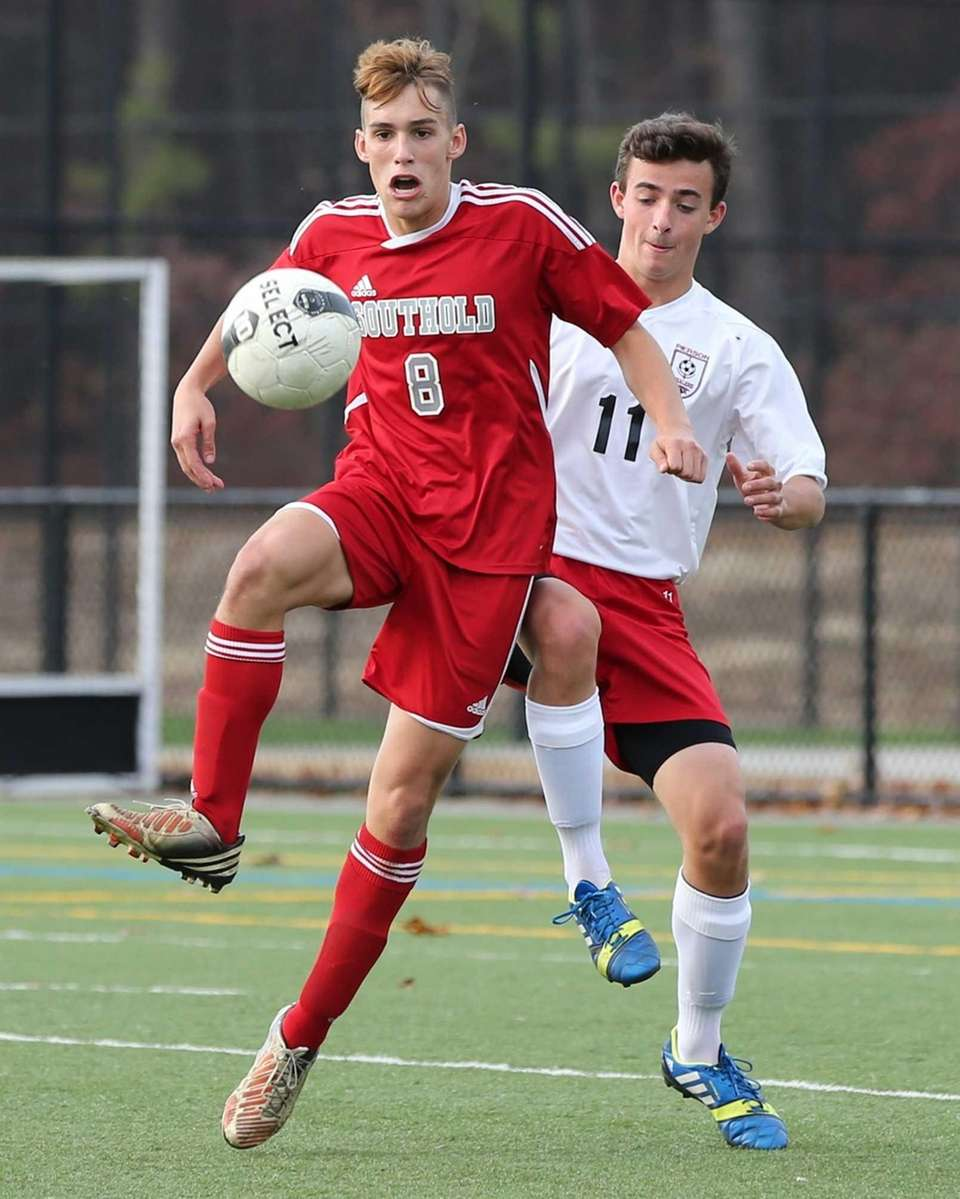Southold's Drew Sacher (no. 8) fights for control
