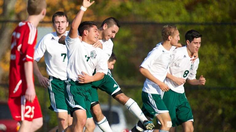 Carle Place midfielder Danny Chavez (no. 11) is