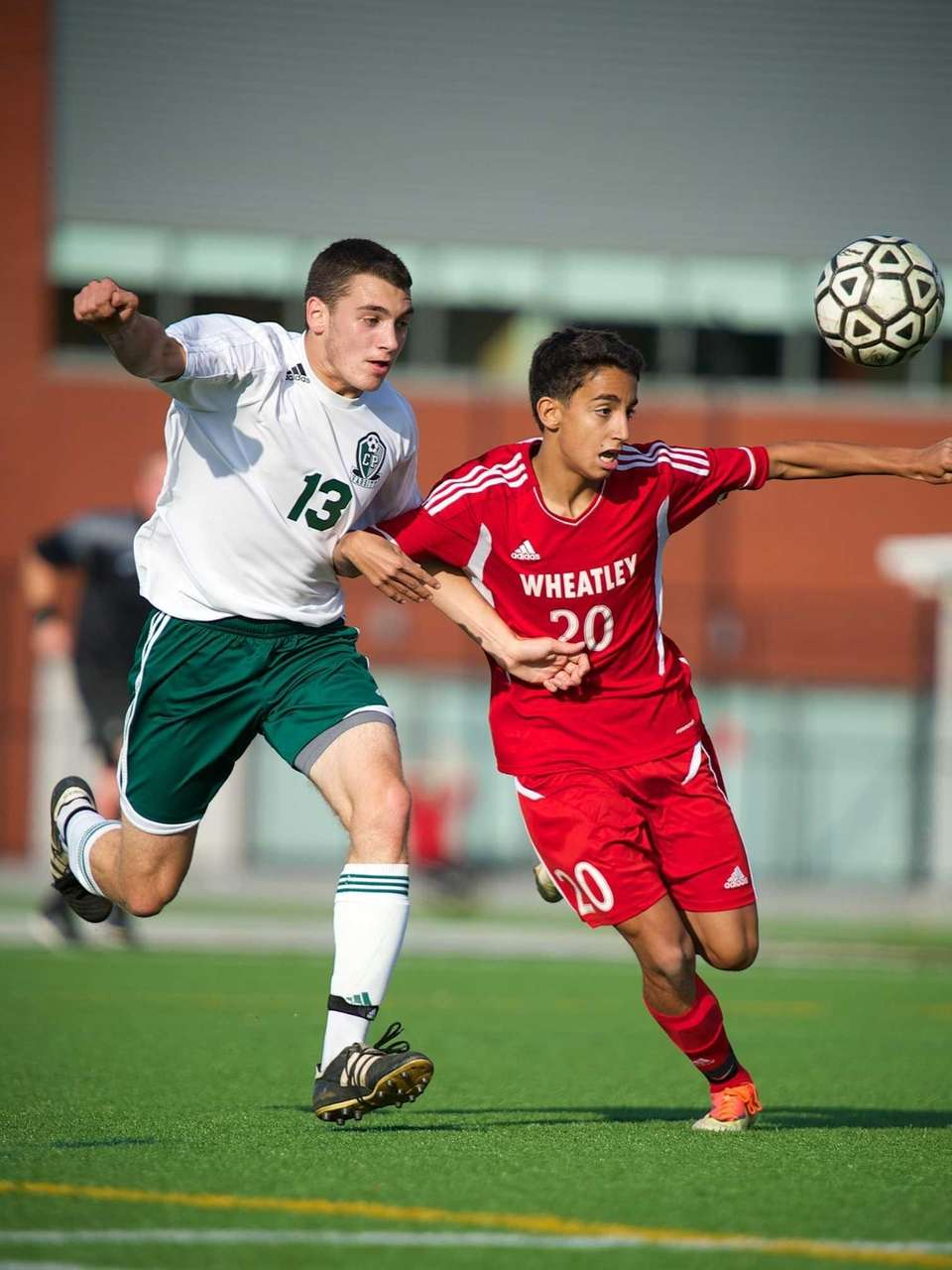 Carle Place defender Nick Hytell (13) battles with