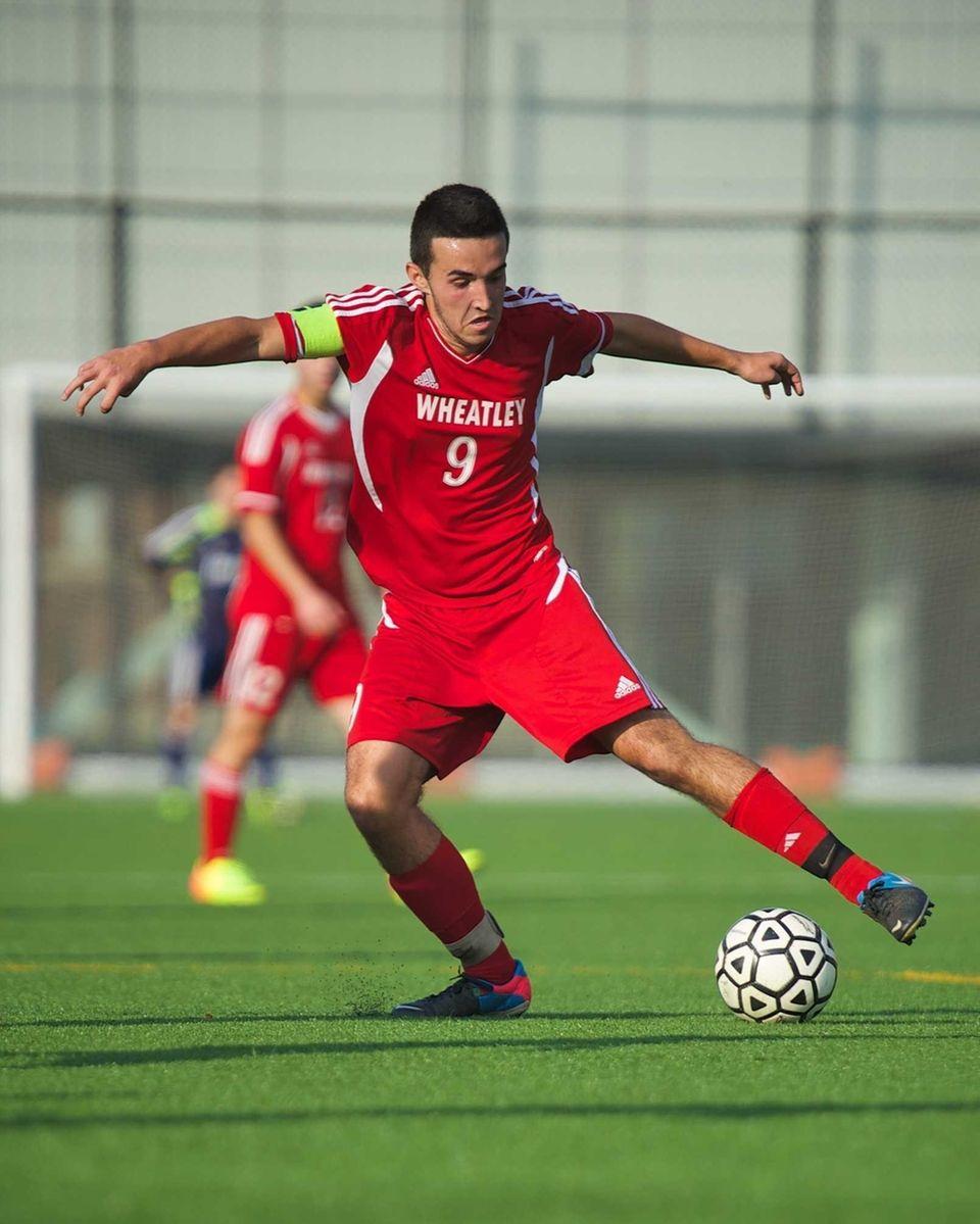 Wheatley midfielder Michael Covas (9) controls the ball