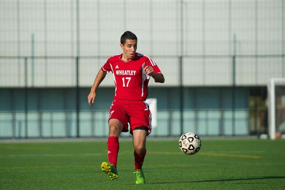 Wheatley midfielder Andrew Mendes (17) passes the ball