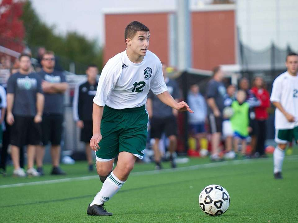 Carle Place midfielder John Losito (12) looks to