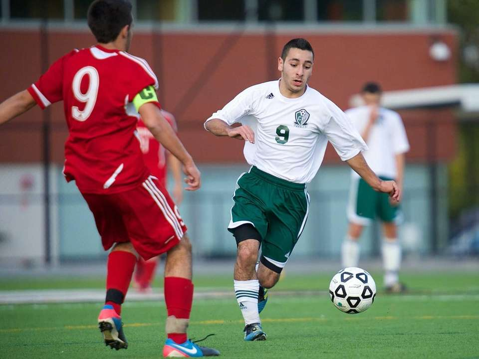 Carle Place midfielder Francesco Irace (9) chases down