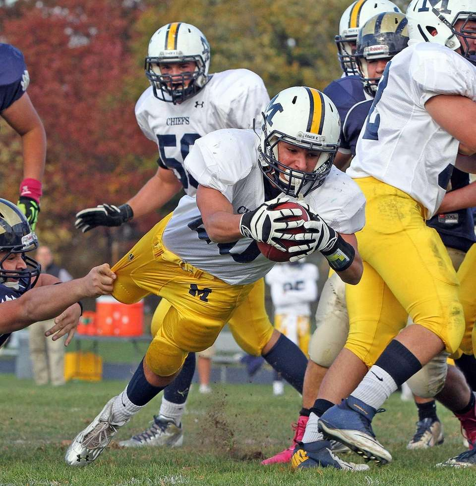 Massapequa's Nick Capuana dives for a touchdown against
