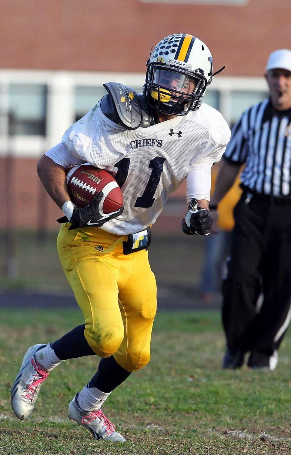 Massapequa's Craig Berge looks to run against Baldwins.