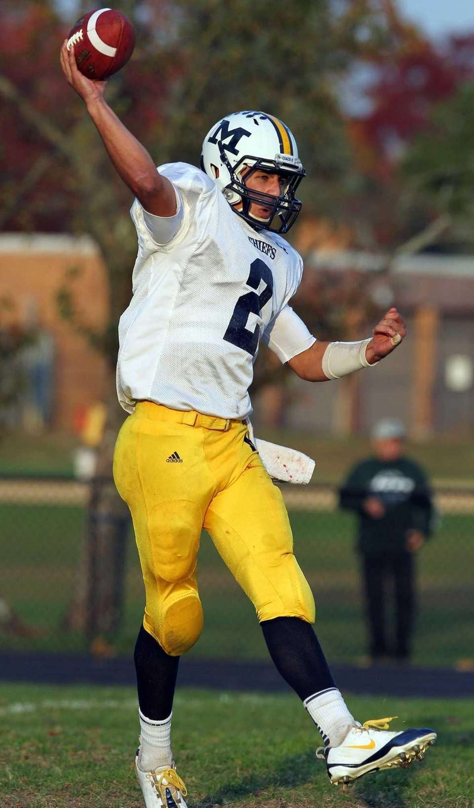 Massapequa's Matthew Caracappa attempts a pass against Baldwin.