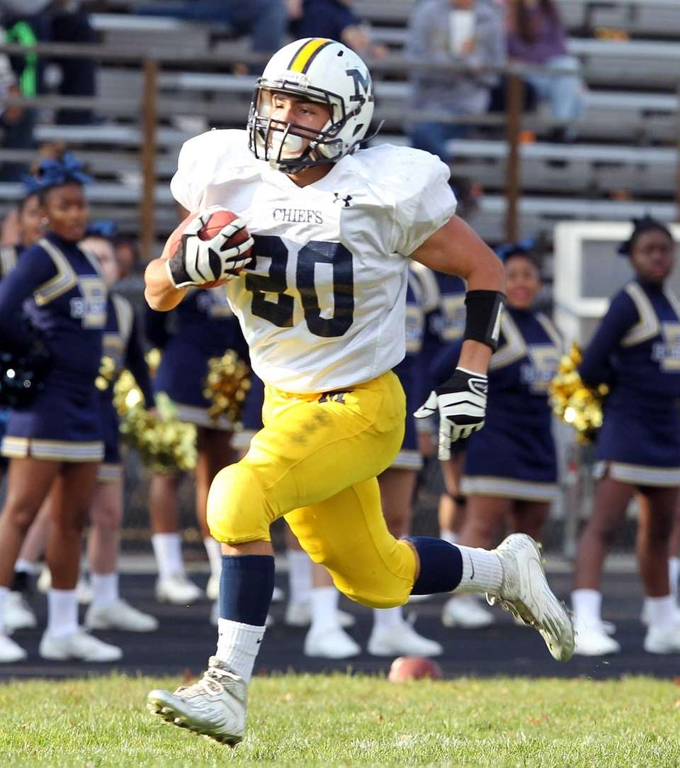 Massapequa's Nick Capuana scores a touchdown against Baldwins.