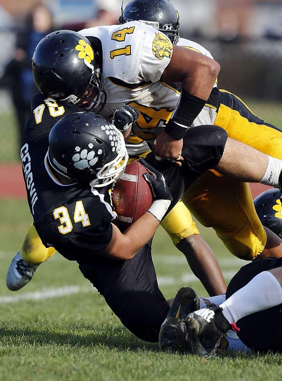 Commack's Josh Valentin (14) takes down Northport's James