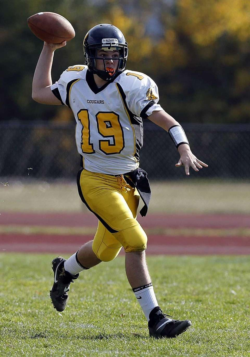 Commack quarterback Robert Paccione looks to pass against